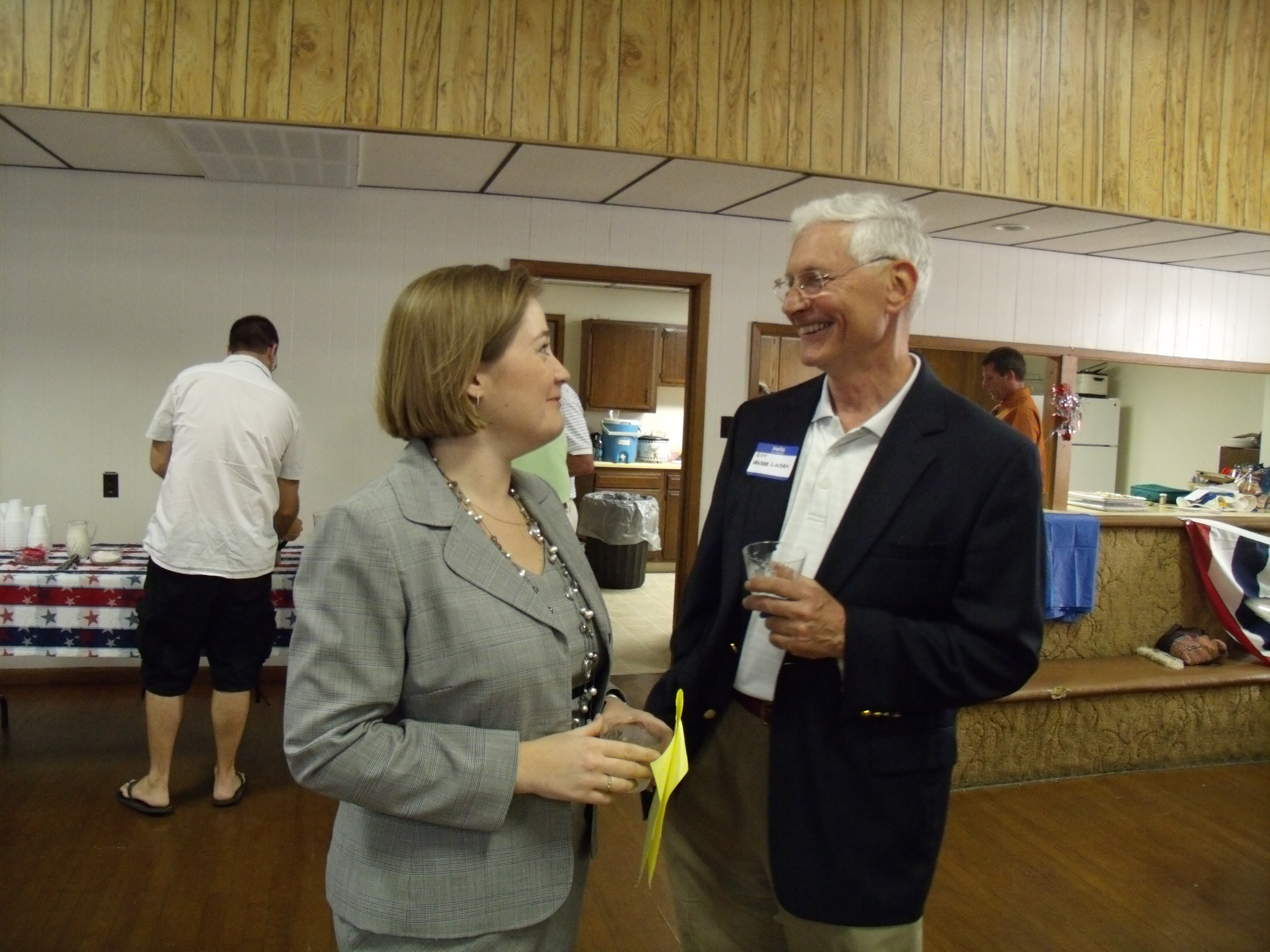 Brenna Findley and Guy Vander Linden catch up on recent State House events during the Poweshiek County Republican social event Friday evening