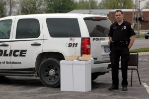 Officer Charlie Valentine stands ready to help residents dispose of their unwanted prescription medications Saturday