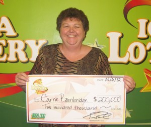 Carrie Bainbridge Claims Two Top Prizes In Iowa's $100,000 Cash Game. (photo courtesy the Iowa lottery)