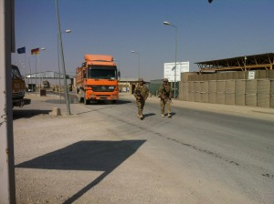 Sgt. George Toubekis (left) walks with a fellow soldier as they guard a fuel truck at Camp Marmal in Mazar-I-Sharif, Afghanistan. (submitted photo)