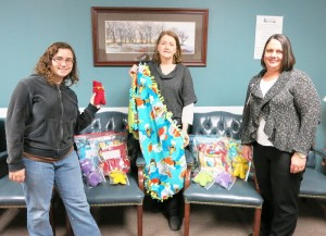 Shown with the donations are, from left: Abigail VanEgmond and Diane Ottosson of the Church of Latter Day Saints, and MHP Director of Emergency Services Andrea Hagist. (submitted photo)