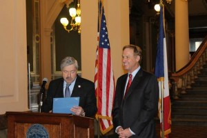 Governor Terry Branstad (L) reads the official State Proclamation for NASCAR Hall of Famer Rusty Wallace (R) during ceremonies in the Capitol Rotunda (February 27, 2013 - Submitted Photo)