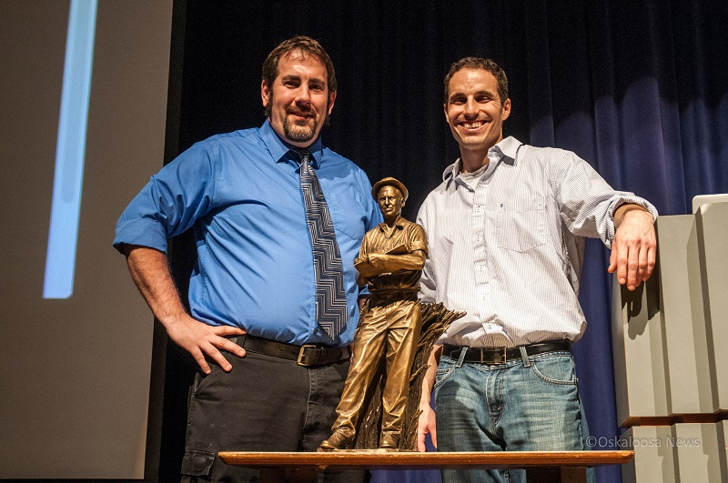 OHS art teacher and sculptor Matt Kargol (left) and Statuary Hall artist Benjamin Victor (right) pose behind the Norman Borlaug miniature when Victor visited George Daily Auditorium in March of 2013.