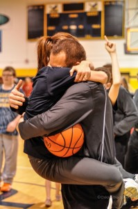 William Penn Head Men's Basketball Coach John Henry and his wife Maggie embrace after the Statesmen won the MCC Championship.