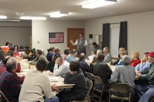 Doland speaks to a group of supporters and landowners in Leighton's community center Thursday evening.