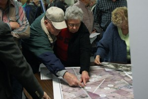This couple looks over a site location map at Thursday evenings informational meeting. (photo by Don Hubbard)
