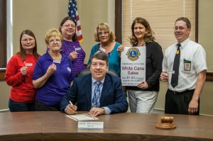Oskaloosa Lions Club members and others joined Mayor Dave Krutzfeldt as he signed a proclamation designating May 11-18 as White Cane Week. The Oskaloosa Lions Club will have miniature white canes available. The proceeds will benefit projects to help the visually impaired.
