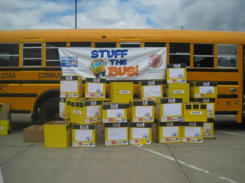 Needed school supplies are stacked up in front of an Oskaloosa school bus Wednesday as 'Stuff the Bus' came to an end. (submitted photo)