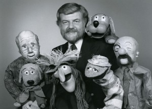 "Duane Ellett surrounded by his creations, including Floppy. The ""Floppytown Gazette"" program aired on Sunday mornings in the 1980s, and featured a variety of puppets who produced the local newspaper, ""The Floppytown Gazette""."