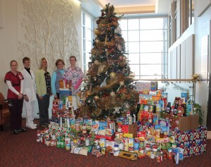 Mahaska Health Partnership Inpatient Services hosted a food drive to benefit the Ecumenical Food Cupboard of Oskaloosa. According to event organizer Theresa McClure, a house supervisor, MHP employees from throughout the health system donated food and hygiene items to assist those in need this holiday season. Members of Inpatient Services pictured with the donations are, from left: Torri Schmitz, Diana Sherman, Stephanie VanderLinden, Theresa McClure and Crystal Cady.