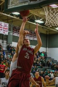 Oskaloosa's Spencer Medlin puts in 2 more of his team leading 13 points against Pella Friday night at Pella. (Photo by Denis Currier/Oskaloosa News)