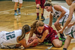 The Oskaloosa High School Girls battled it out with rival Pella on Friday night in Pella. (photo by Denis Currier/Oskaloosa News)