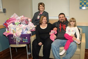 MHP's 2014 New Year's Baby is Khloee Jean Watts, who entered the world at 12:47 am on Jan. 1. She received a great gift basket from MHP to celebrate her arrival. Khloee is shown with, from left: MHP Birthing Center Director Chyann Vroegh, her mother, Christine, her father, Nathan and big sister, Katelynn.