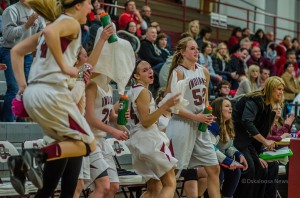 The Oskaloosa bench reacts as the time runs out against Newton Tuesday night.