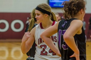Oskaloosa's Alexis Westercamp shares her excitement with teammates Friday night.