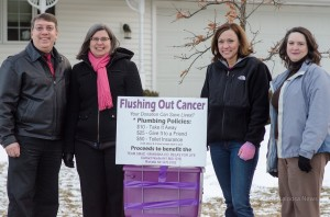 The Krutzfeldt's (left) and members of Team SMAC (right) with the Purple Toilet.