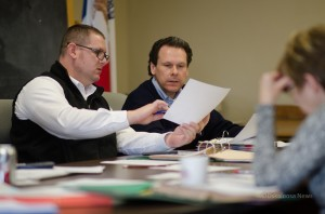 Mahaska County Supervisors Mark Doland and Greg Gordy go over some documents on Monday, February 3, 2014.