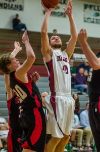 Oskaloosa Varsity Boys Basketball had their hands full with the Big Reds who are riding a 10 game win streak.