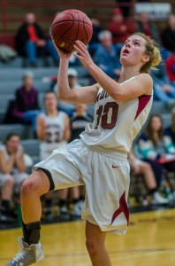 Oskaloosa's Taylor Richardson drives to the hoop for another two points against Newton.