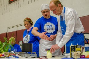Chef Michael Glesener and Congressman Dave Loebsack cook up stew at the Oskaloosa Blue Zone kick-off event Monday night.