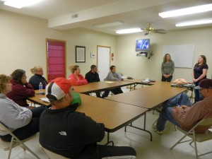 Oskaloosa Little League board trains on the AED (submitted photo)