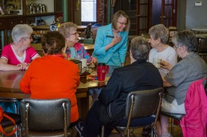 Dr. Mariannette Miller-Meeks (R) talks with a group of women at Smokey Row this past week.