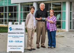 Shown at the check presentation are, from left: Oskaloosa Free Clinic Treasurer Stephanie Faulkes, Oskaloosa Free Clinic Advisory Board President Roger Parlett and Mahaska County Outreach Thrift Store Manager Alice Moore. (submitted photo)