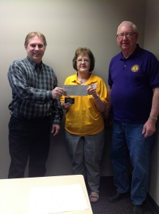 Pictured below, left to right: Calvin Bandstra, MCCF Board Member/Secretary Leslie Nuehring, Lions Club KidSight Coordinator Arvene Bradley, Lions Club Incoming President   Thanks to a grant from the Mahaska County Community Foundation, the local Lions Club was able to purchase a digital camera in which to screen the eyesight of many local children. This service to the community and county has been especially beneficial due to the recent requirement that all children have a vision screening before entering school. If your preschool would like to schedule a vision screening, please contact Leslie Nuehring, the KidSight coordinator at 641-660-3855. The Lions Club will also be providing screenings this summer at the Southern Iowa Fair.