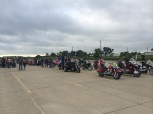 Patriot Guard Riders line up and prepare to escort the body of Lance Corporal Adam Wolff, from the Cedar Rapids airport back to his hometown of Ottumwa, (photo by Shelly Spaur)
