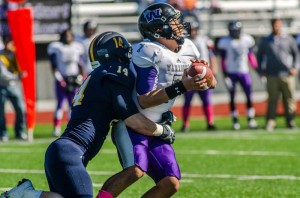 Nick DiMarco (#14) sacks the Waldorf quarterback in last seasons match-up.
