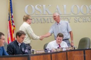 Charlie Comfort (left) shakes hands with Oskaloosa School Board President Carl Drost (right) moments after Comfort submitted his resignation.