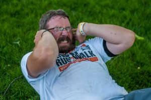 Oskaloosa Resident AJ Hodgeman struggles to finish out some reps at Sunday's workout on the square.