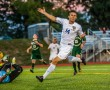 Andrew Valett celebrates his first goal in the navy and gold