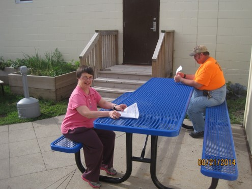 Mahaska County Community Foundation grants Christian Opportunity Center's Oskaloosa location commercial picnic tables for outdoor work area.