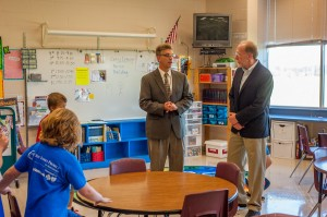 Oskaloosa Elementary School Principal Mike Dursky (left) talks with Congressman Dave Loebsack (right) on Wednesday.