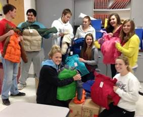 OHS Peer Helpers preparing coats for distribution.