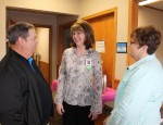 New Sharon Medical Center, a service of Mahaska Health Partnership in Oskaloosa, held an open house on April 8 to welcome Family Nurse Practitioner Lisa Smith, ARNP-C, to the practice as the full-time provider. Smith, a New Sharon resident, said she is excited to be meeting the healthcare needs of her home community. Smith, center, is shown with Steve and Jo Wiley of New Sharon at the open house.