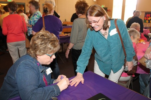 Judi Veldhuizen of Mahaska Health Partnership Public Health Services paints Volunteer Carol Huffman's nail as part of the Volunteer Appreciation Luncheon held April 13. Volunteers from Mahaska and Keokuk counties were honored for selflessly lending a helping hand to benefit of MHP patients, visitors and staff.  More than 120 people attended the luncheon. Volunteers can be found throughout the health system, including Hospice Services in both Mahaska and Keokuk counties, chaplains, hospital gift shop volunteers and surgical services liaisons. Volunteers also serve on various boards and advisory committees. MHP officials enjoyed the opportunity to thank its more than 250 volunteers for making healthcare personal. For more information about volunteer opportunities at MHP, call 641.672.3342.