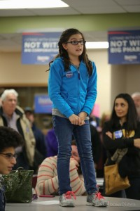 Andrea Heakin, 9, took an opportunity to advocate for Bernie Sanders in Oskaloosa on Monday night. (photo by Denis Currier/Oskaloosa News)