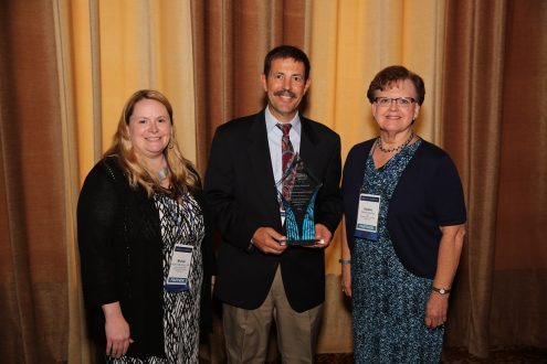 Shown with the Excellence in Patient Care Award from the Studer Group, an outcomes-based healthcare performance improvement company; are MHP Director of Surgical Services Michele Manternach, RN; MHP CEO Jay Christensen and MHP Chief Nursing Officer Darlene Keuning, RN, BSN, MS.