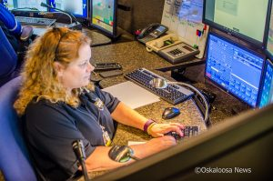 Janel Legvold works the 911 console at the Mahaska County 911 Center