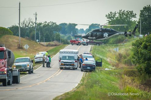 An air ambulance lands on 310th Street east of Bussey on Friday afternoon.