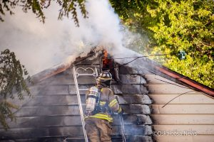 Oskaloosa firefighters battled a house fire in the 1000 block of 1st Avenue West on Saturday afternoon.