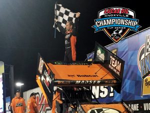 Ian Madsen celebrates a feature win and a championship at Knoxville (Knoxville Raceway Photo)