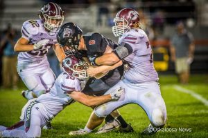 The Oskaloosa Indians tamed the Tigers on Friday night on the road in Grinnell.