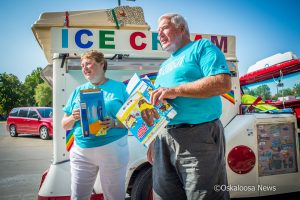 Kate and Bob Shaw hand out ice cream at Mahaska Health Partnership on Monday.