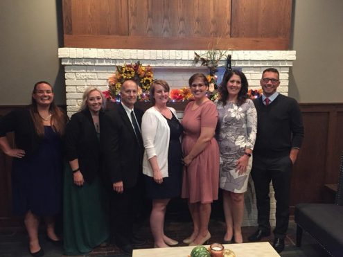 Katie Orlando, from BBBS of Northeast Iowa (left). Pictured with Katie are members of the advisory board in attendance. Left to right, Katie Orlando, Molly Coster, Steve Burnett, Amy Meyer, Katie Trainer, Debbie Guild, Matt Tippett. (submitted photo)