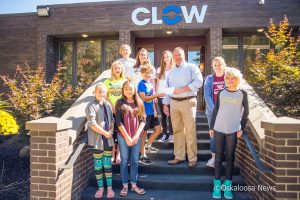 Oskaloosa, Iowa - Members of the Oskaloosa Middle School Student Council met on Friday with Mark Willett of CLOW Valve Company. Willett presented the students with a donation to allow them to attend the Iowa Student Council Conference.