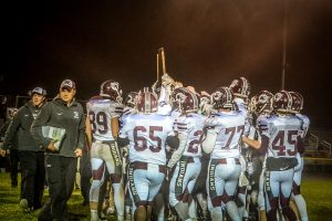 The Oskaloosa Indians are presented with the 2017 State Football Trophy. (photo by Wendy Van Roekel)