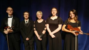 Students selected for the Iowa All-State Music Festival from left to right: Mark De Ronde - violin, Nicholas Ingamells - choir, Kinsey Cook - horn, Rhyienne Fowler - choir, and Ellie Snyder - violin. (submitted photo)